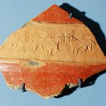 Fragment of a stamped karas-vessel band with lion images 10th-11th centuries